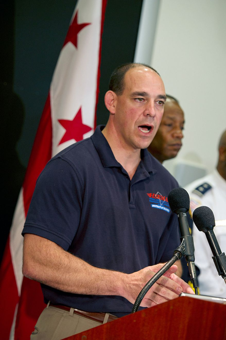 """Chris Geldart, director of the D.C. Homeland Security and Emergency Management Agency, warned that Sandy's high winds will definitely cause downed trees, and he urged those who live near large trees that are likely to come down to move to the lower levels of their homes. He joined the mayor and other safety officials to discuss the preparations being made for the so-called """"Frankenstorm"""". (Barbara L. Salisbury/The Washington Times)"""