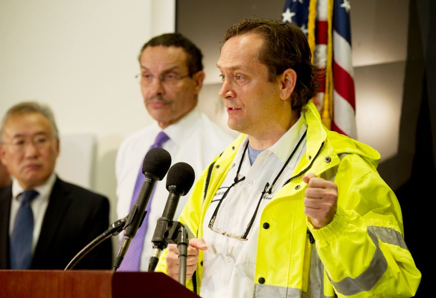 "George Hawkins, general manager of D.C. Water, says he doubts there will be a drop in water pressure but gave people instructions to save bottled water just in case. He joined the mayor and other safety officials to discuss the District's preparations for Sandy, the so-called ""Frankenstorm"" that is expected to hit the area by Monday morning. (Barbara L. Salisbury/The Washington Times)"