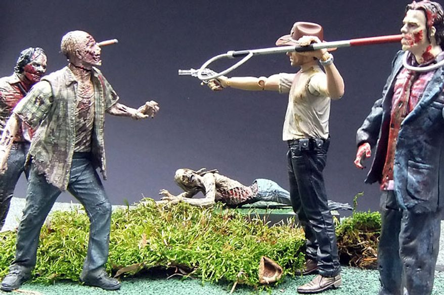 McFarlane Toys' Deputy Rick Grimes is surrounded by zombies from The Walking Dead action figure collection. (Photograph by Joseph Szadkowski / The Washington Times)