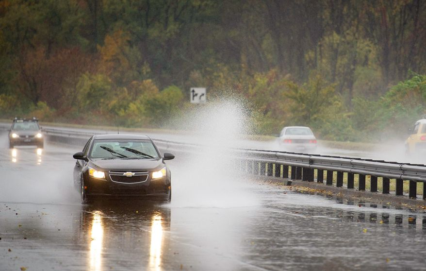 A car hydroplanes in standing water northbound on the George Washington Memorial Parkway neat Gravelly Point in Alexandria on Monday as Hurricane Sandy smashes the Atlantic Coast with devastating winds and heavy rain. (Rod Lamkey Jr./The Washington Times)