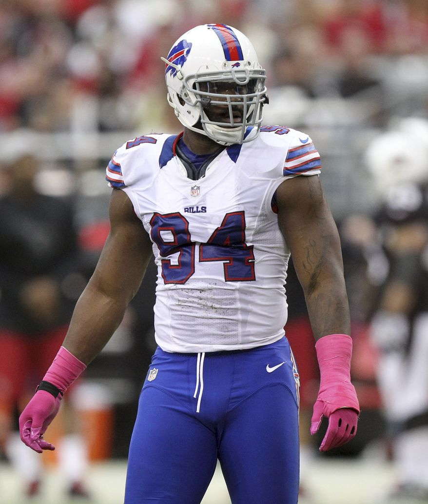 FILE - This Oct. 14, 2012 file photo shows Buffalo Bills' Mario Williams during a timeout against the Arizona Cardinals in an NFL football game in Glendale, Ariz. A person familiar with Williams says the Bills defensive end is visiting a specialist to determine whether to have surgery to repair a nagging left wrist injury. The person spoke on the condition of anonymity on Wednesday, Oct. 24, 2012, because the team had not released that information. (AP Photo/Paul Connors, File)