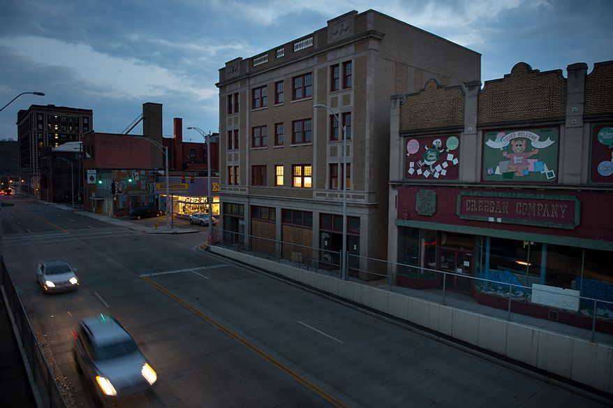 A few cars pass through downtown Steubenville, Ohio, Friday, October 26, 2012. Once a productive steel town, Steubenville, Ohio's population has contracted faster than anywhere else in the country between 1980 and 2000 as their steel plants shut down. The area has seen a drop in unemployment in recent years due in part to the prospects of natural gas but the city still has a long way to go with unemployment figures higher then the the rest of the state and the country. (Andrew Harnik/The Washington Times)