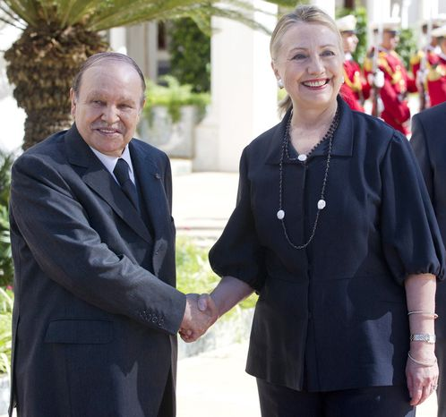 Algerian President Abdelaziz Bouteflika, left shakes hands with US Secretary of State Hillary Rodham Clinton, as she arrives for meetings, at the Mouradia Palace, in Algiers, Algeria, Monday, Oct. 29, 2012. U.S. Secretary of State Hillary Rodham Clinton sought Algeria's assistance on Monday for any future military intervention in Mali, pressing the North African nation to provide intelligence, if not boots on the ground to help rout the al-Qaida-linked militants across its southern border. Clinton, on the first stop of a five-day trip overseas, met with Algerian President Abdelaziz Bouteflika as the United States and its allies ramped up preparations to fight northern Mali's breakaway Islamist republic. (AP Photo, Saul Loeb, Pool)