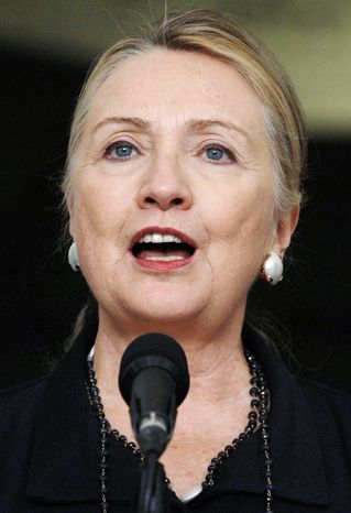 U.S. Secretary of State Hillary Rodham Clinton talks to reporters after her meeting with Algerian President Abdelaziz Bouteflika in Algiers, Monday, Oct. 29, 2012.    (AP Photo/Sidali Djarboub)