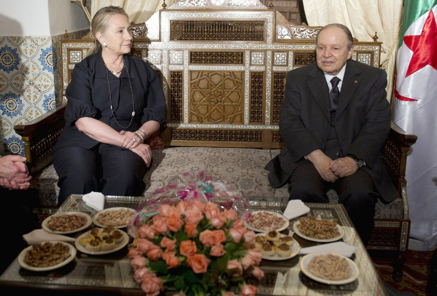 Algerian President Abdelaziz Bouteflika, right, talks with US Secretary of State Hillary Rodham Clinton, at the Mouradia Palace, in Algiers, Algeria, Monday, Oct. 29, 2012. Clinton, on the first stop of a five-day trip overseas, met with Algerian President Abdelaziz Bouteflika as the United States and its allies ramped up preparations to fight northern Mali's breakaway Islamist republic. (AP Photo, Saul Loeb, Pool)