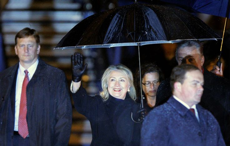 U.S. Secretary of State Hillary Rodham Clinton waves on arrival at Sarajevo Airport, Bosnia Monday, Oct. 29, 2012. Clinton left Algeria for three days of talks in the Balkans, arriving Monday night in the Bosnian capital of Sarajevo. She plans to join the European Union's top diplomat in meetings with the leaders of Bosnia, Serbia and Kosovo, urging those nations to make the necessary reforms to join the EU and NATO. She'll finish with meetings in Croatia and Albania, NATO's two newest members. (AP Photo/Amel Emric)