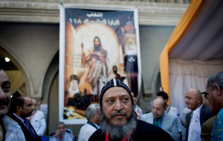 A Coptic clergyman leaves after he registered for voting during the new Coptic Pope elections at the main Coptic cathedral in Cairo, Egypt, Monday, Oct. 29, 2012. A council of Egypt's Coptic Christians is voting Monday in a process that will elect a new spiritual leader for the ancient church as the community struggles to assert its identity and role amid a rising tide of Islamism that has left many Copts fearful for their future. (AP Photo/Nasser Nasser)