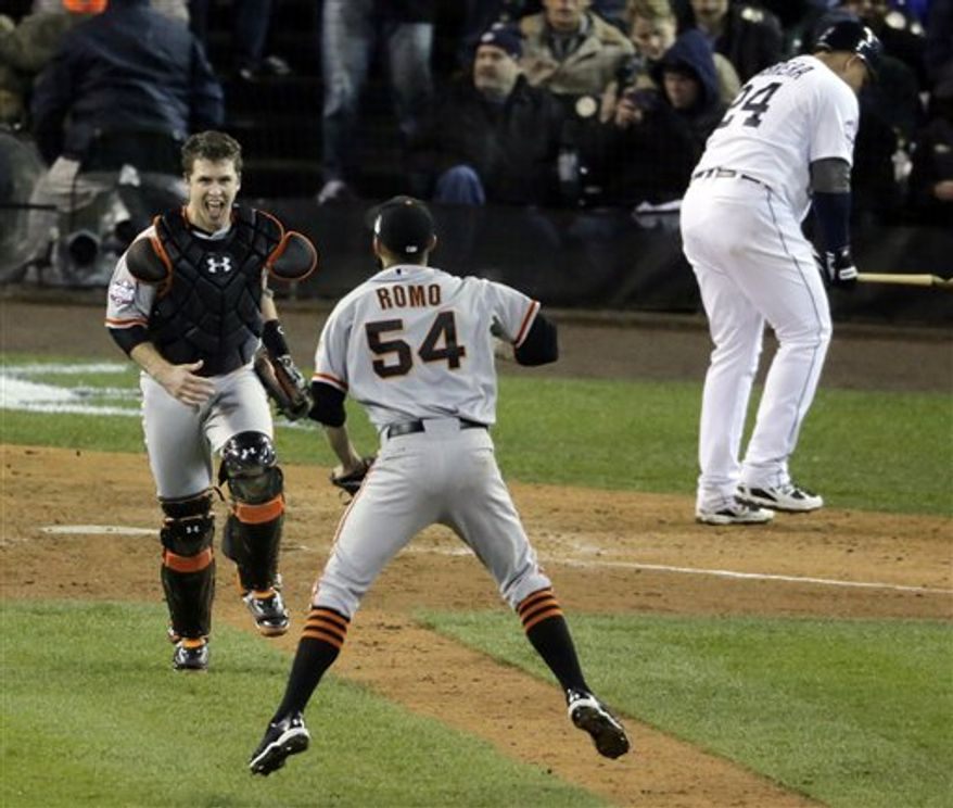 San Francisco Giants catcher Buster Posey and San Francisco Giants relief pitcher Sergio Romo (54) celebrate after striking out Detroit Tigers third baseman Miguel Cabrera (24) to win Game 4 of baseball's World Series Sunday, Oct. 28, 2012, in Detroit. The Giants won 4-3. (AP Photo/Charlie Riedel)