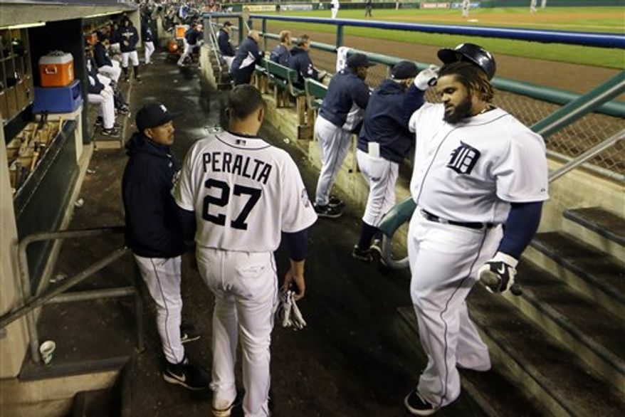 Detroit Tigers first baseman Prince Fielder, right, walks into the digout after striking out during the eighth inning of Game 4 of baseball's World Series Sunday, Oct. 28, 2012, in Detroit. (AP Photo/Matt Slocum)