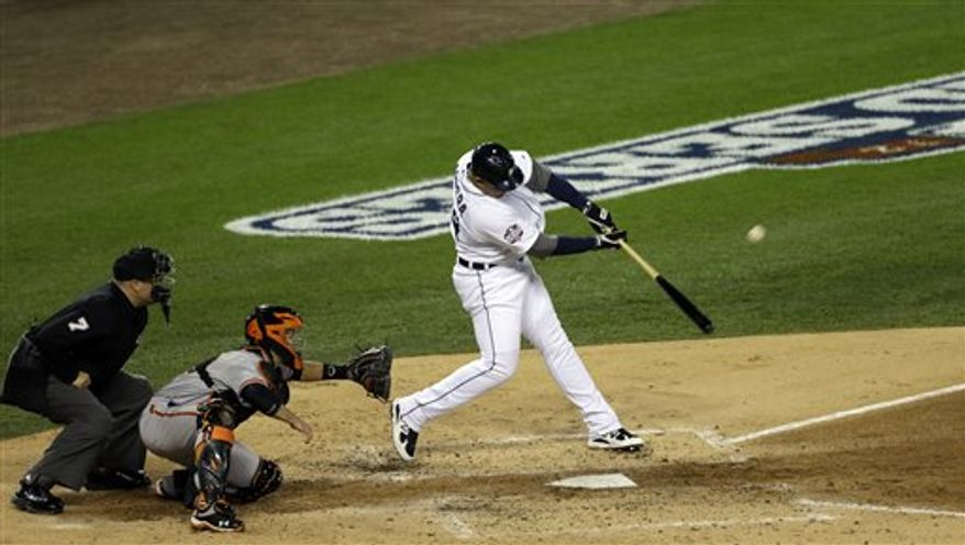 Detroit Tigers' Miguel Cabrera hits a two-run home run during the third inning of Game 4 of baseball's World Series against the San Francisco Giants Sunday, Oct. 28, 2012, in Detroit. (AP Photo/Paul Sancya )