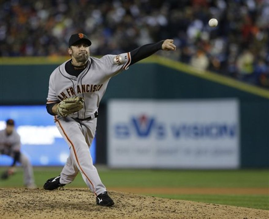 San Francisco Giants' Jeremy Affeldt throws during the eighth inning of Game 4 of baseball's World Series against the Detroit Tigers Sunday, Oct. 28, 2012, in Detroit. (AP Photo/Matt Slocum)