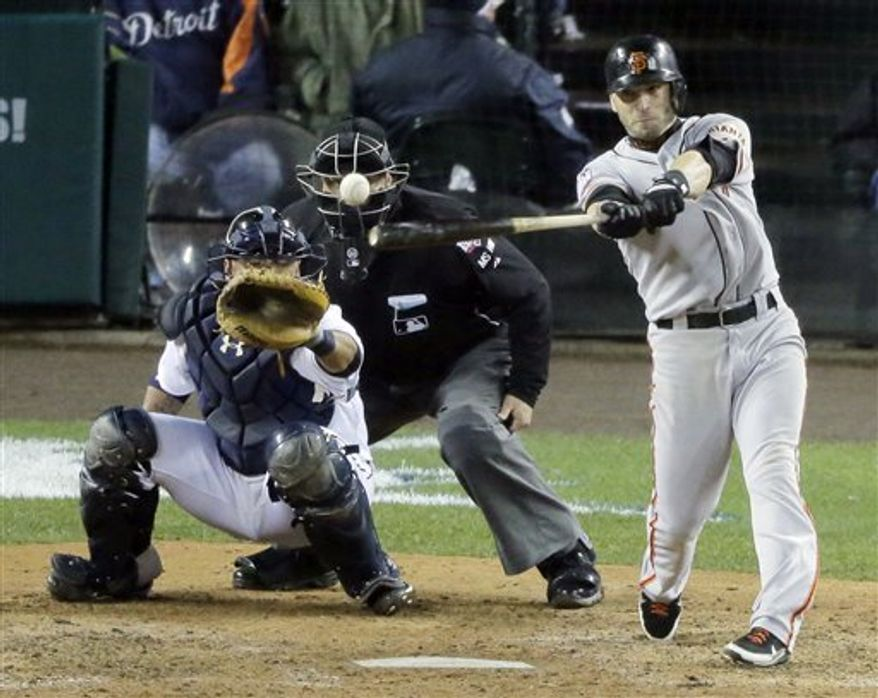 San Francisco Giants second baseman Marco Scutaro hits an RBI single during the 10th inning of Game 4 of baseball's World Series against the Detroit Tigers Sunday, Oct. 28, 2012, in Detroit. (AP Photo/Charlie Riedel)