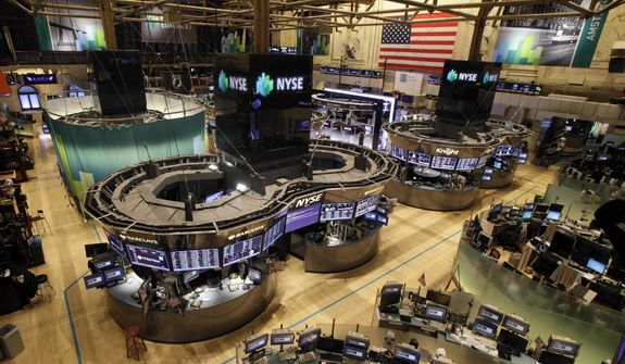 The floor of the New York Stock Exchange is empty of traders, Monday, Oct. 29, 2012, in New York. All major U.S. stock and options exchanges will remain closed Monday with Hurricane Sandy nearing landfall on the East Coast. Trading has rarely stopped for weather. (AP Photo/Richard Drew)