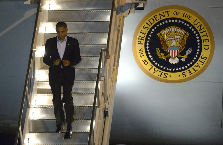 President Obama deplanes from Air Force One after arriving at Orlando International Airport in Orlando, Fla., on Sunday, Oct. 28, 2012. (AP Photo/Phelan M. Ebenhack)