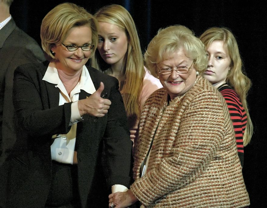 **FILE** Claire McCaskill (left), gives the thumbs up to supporters as she holds the hand of her mother, Betty Anne McCaskill, after participating in a debate for U.S. Senate candidates against incumbent Sen. Jim Talent at Clayton High School in Clayton, Mo., on Oct. 11, 2006. (Associated Press)