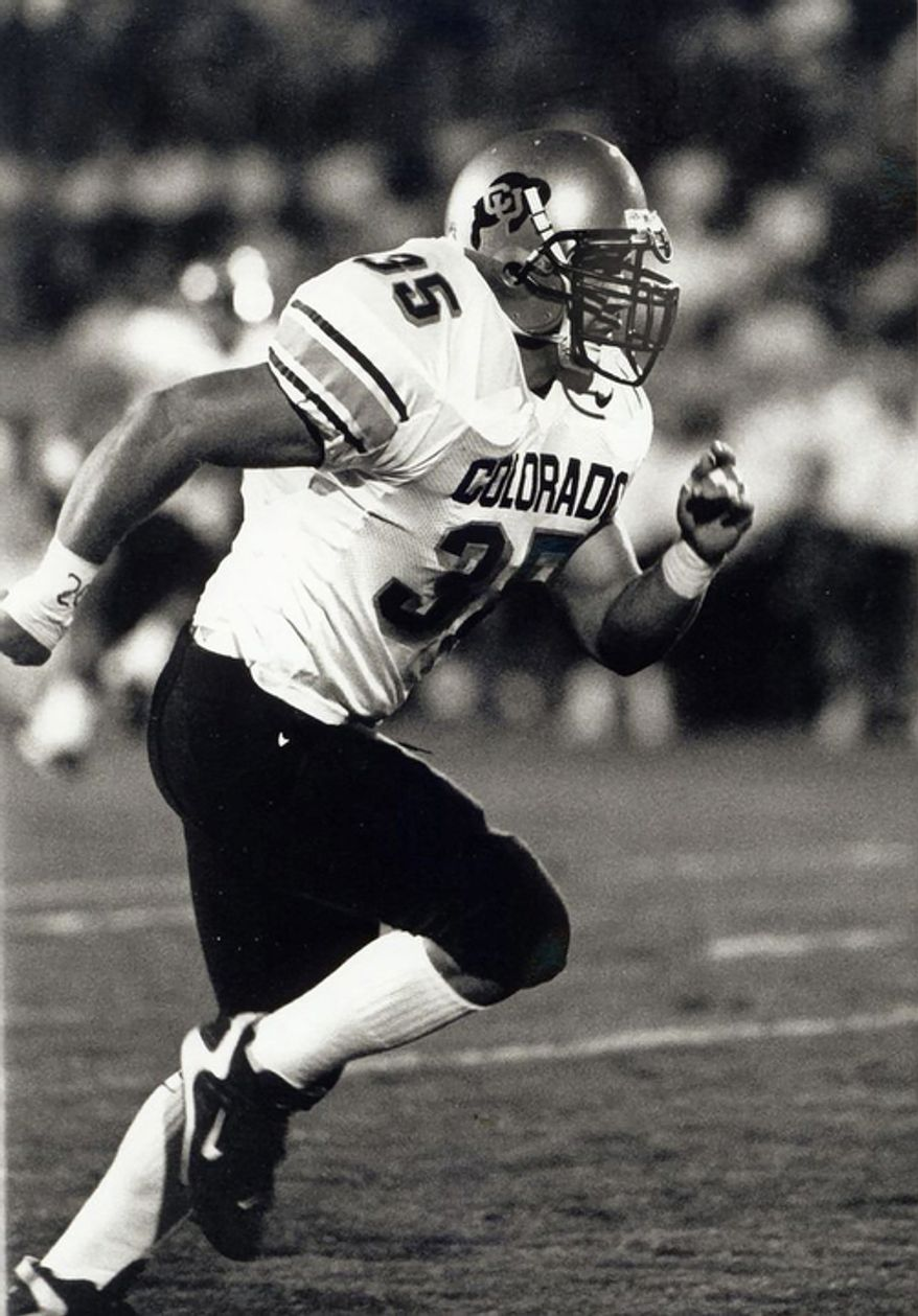 "Keith Miller rushes down the field as a fullback for the NCAA college football team at the University of Colorado. Miller has reinvented himself, going from the gridiron to the stage and will appear in Verdi's ""Un Ballo in Maschera,"" at the Metropolitan Opera in New York.  (AP Photo/University of Colorado)"