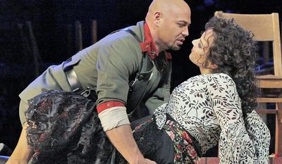 "Keith Miller, left, plays Zuniga in Bizet's ""Carmen"" with Elina Garanca in the title role at the Metropolitan Opera in New York. Miller, a former University of Colorado fullback, has reinvented himself, going from the gridiron to the stage and will appear in Verdi's ""Un Ballo in Maschera,"" at the Metropolitan Opera. Performances begin Thursday, Nov. 8, 2012. (AP Photo/Metropolitan Opera, Ken Howard)"