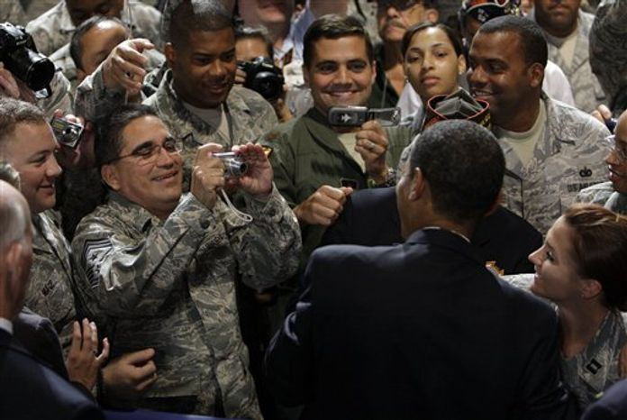** FILE ** In this Aug. 17, 2009 file photo, President Barack Obama poses for a picture after speaking at the Veterans of Foreign Wars National Convention in Phoenix. (AP Photo/Alex Brandon, File)