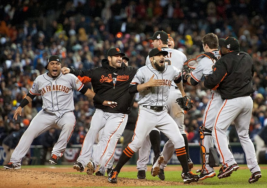 The San Francisco Giants celebrate defeating the Detroit Tigers in Game 4 of baseball's World Series on Sunday, Oct. 28, 2012, in Detroit. The Giants won the World Series 4-0. (AP Photo/The Sacramento Bee, Paul Kitagaki Jr.)  MAGS OUT; LOCAL TV OUT (KCRA3, KXTV10, KOVR13, KUVS19, KMAZ31, KTXL40); MANDATORY CREDIT