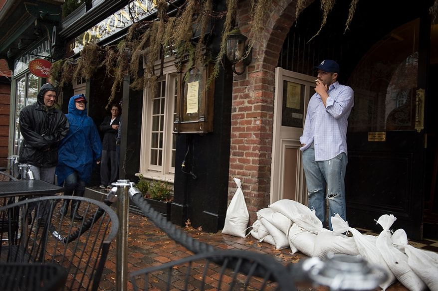 Jeff Sciscilo, of Alexandria, Va., takes time for a cigarette while visiting O'Connell's Restaurant in Old Town Alexandria, Va., Monday, Oct. 29, 2012, while Hurricane Sandy makes it's way north along the Atlantic coast. (Rod Lamkey Jr./The Washington Times)