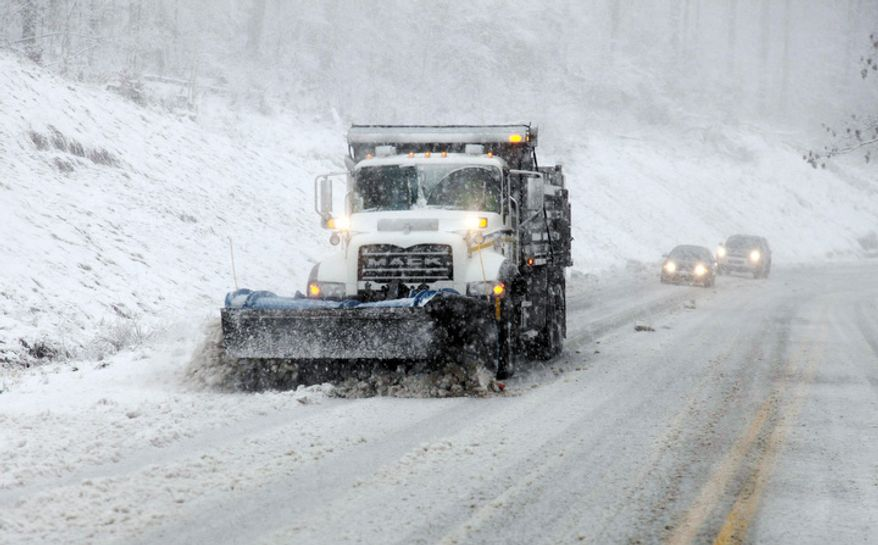 Snow plows move through the mountains of West Virginia Monday, Oct. 29, 2012, in Randolph County, W.Va. Sandy was set to collide with a wintry storm from the west and cold air streaming down from the Arctic. The combination superstorm could menace some 50 million people in the most heavily populated corridor in the nation, from the East Coast to the Great Lakes. (AP Photo/Robert Ray)