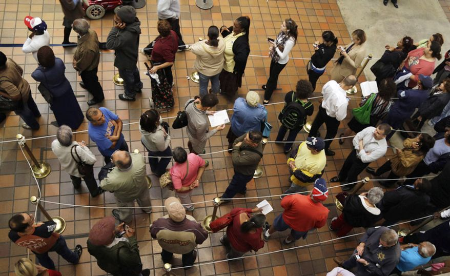 People stand in line to vote during early voting for the presidential election in Miami. About 1.9 million Floridians have already cast ballots eight days before Election Day, Nov 6. (AP Photo/Lynne Sladky)