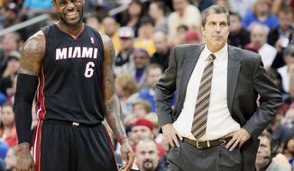 LeBron James and world champion Miami face Boston on Tuesday, while Washington coach Randy Wittman and the Wizards start their season at Cleveland. Also, Dallas visits the Los Angeles Lakers. (Associated Press)