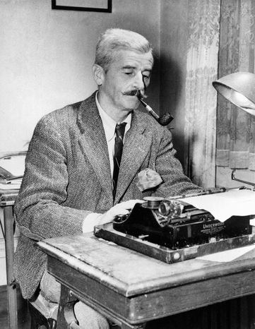 American novelist William Faulkner works at his Underwood typewriter in his study at his Rowan Oaks home near Oxford, Miss., in Nov. 1950. (AP Photo)