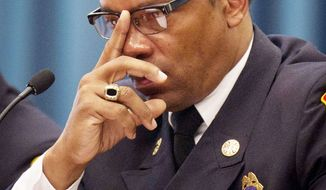An arbitrator ruled Fire Chief Kenneth Ellerbe retaliated against the president D.C. firefighters union by transferring him to another job and seeking to manufacture a justification for the move. (Rod Lamkey Jr./The Washington Times)