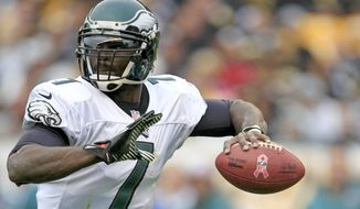 FILE - This Oct. 7, 2012 file photo shows Philadelphia Eagles quarterback Michael Vick (7) looking to pass in the third quarter of an NFL football game against the Pittsburgh Steelers in Pittsburgh. Despite speculation that Vick's starting job was in jeopardy, he's still the No. 1 quarterback for the Eagles. He'll face his old team on Sunday, the Atlanta Falcons (6-0). (AP Photo/Gene J. Puskar, File)