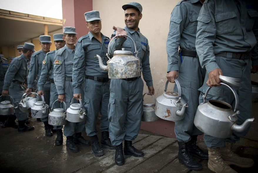 Afghan National Police officers line up with pots to get their breakfast at the Police Academy in Kabul, Afghanistan, Tuesday, Oct. 9, 2012. NATO defense leaders gathering in Brussels Tuesday are committed to the war in Afghanistan, according to U.S. and alliance officials, but there are growing signs that the Afghan political and military hostilities against the coalition are starting to wear on the coalition. (AP Photo/Anja Niedringhaus)
