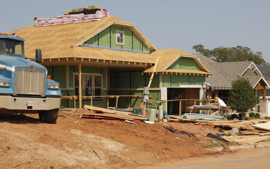A new home is under construction in Edmond, Okla., on Friday, Sept. 21, 2012. (AP Photo/Sue Ogrocki)