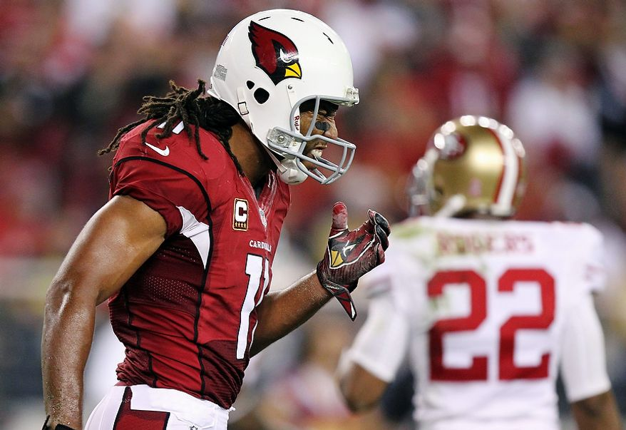 Arizona Cardinals wide receiver Larry Fitzgerald (11) reacts to a missed pass against the San Francisco 49ers during the second half of an NFL football game on Monday, Oct. 29, 2012, in Glendale, Ariz. The 49ers won 24-3. (AP Photo/Paul Connors)