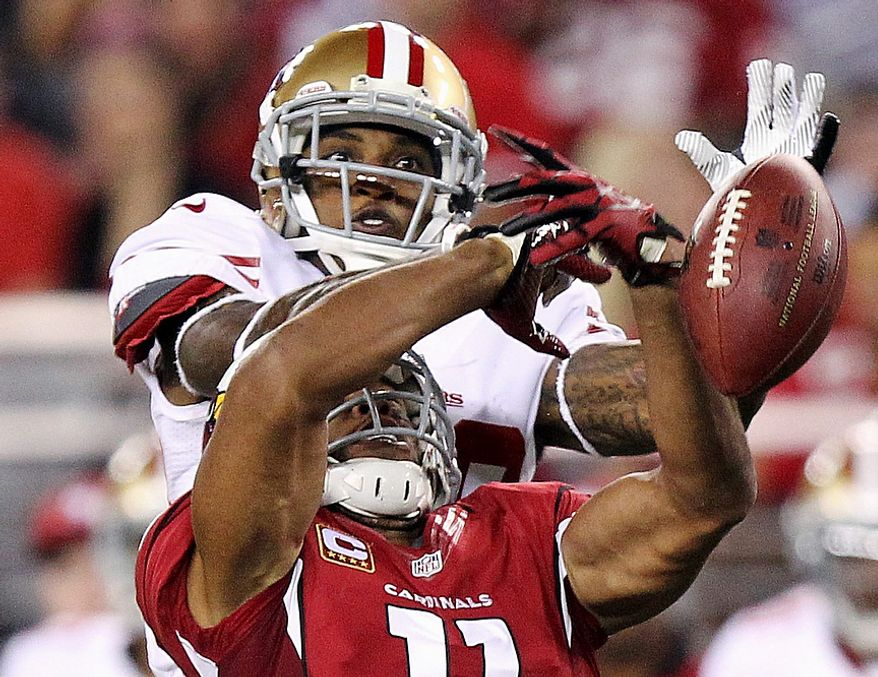 San Francisco 49ers defensive back Chris Culliver breaks up a pass intended for Arizona Cardinals wide receiver Larry Fitzgerald (11) during the first half of an NFL football game on Monday, Oct. 29, 2012, in Glendale, Ariz. (AP Photo/Paul Connors)