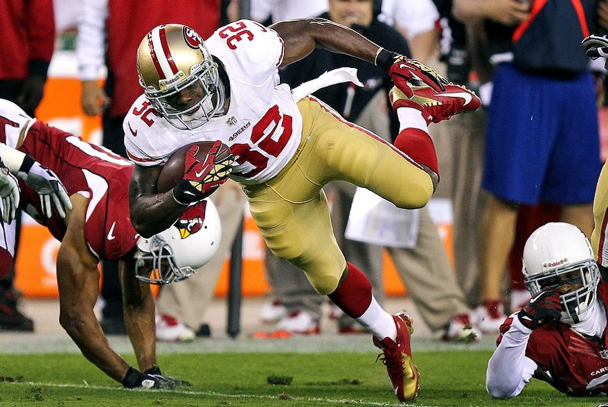 San Francisco 49ers running back Kendall Hunter (32) is tripped up against the Arizona Cardinals during the first half of an NFL football game, Monday, Oct. 29, 2012, in Glendale, Ariz. (AP Photo/Paul Connors)