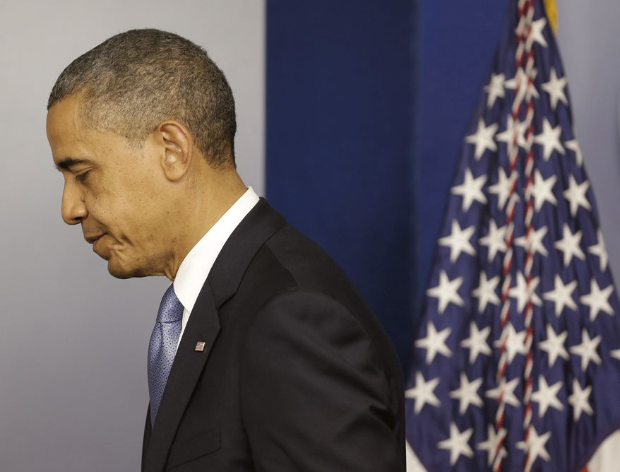 President Barack Obama walks away from the podium after speaking in the White House Briefing Room in Washington, Monday, Oct. 29, 2012, after returning to the White House from a campaign stop in Florida to monitor Hurricane Sandy. (AP Photo/Pablo Martinez Monsivais)