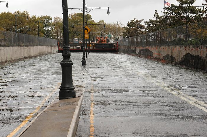 Water reaches street level at the West Street entrance to the Battery Park Underpass, Tuesday, Oct. 30, 2012, in New York. Sandy, the storm that made landfall Monday, caused multiple fatalities, halted mass transit and cut power to more than 6 million homes and businesses. (AP Photo/ Louis Lanzano)