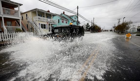 A National Guard humvee travels through high water to check the area after the effects of Hurricane Sandy Tuesday, Oct. 30, 2012, in Ocean City, Md.  Sandy, the storm that made landfall Monday, caused multiple fatalities, halted mass transit and cut power to more than 6 million homes and businesses. (AP Photo/Alex Brandon)