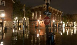 High tide raises floodwaters in Alexandria