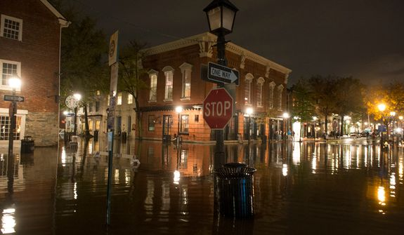 Flooding in Old Town Alexandria. (Rod Lamkey Jr./The Washington Times)