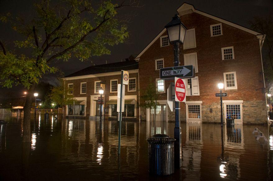 Flooding in Old Town Alexandria. (Rod Lamkey Jr./The Washington Times)