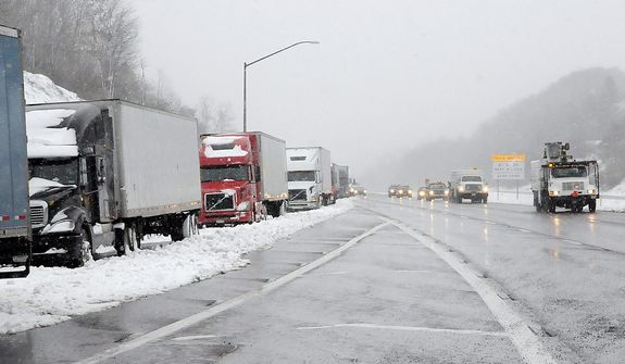 Tractor trailer traffic was halted along Interstate 68 in Frostburg, Md., on Oct. 30, 2012 due to the storm. Wet snow and high winds spinning off the edge of superstorm Sandy spread blizzard conditions over parts of West Virginia and neighboring Appalachian states Tuesday. Authorities closed nearly 50 miles of Interstate 68 on either side of the West Virginia-Maryland state line because of blizzard conditions and stuck cars. Eastbound lanes in Maryland ere later reopened. (AP Photo/Cumberland Times-News, Steven Bittner) WHAG-TV OUT