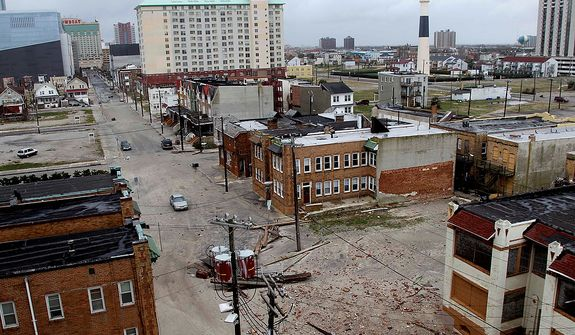 Sand and debris covers the streets near the water in Atlantic City, N.J., Tuesday, Oct. 30, 2012. Sandy, the storm which was downgraded from a hurricane just before making landfall, caused multiple fatalities, halted mass transit and cut power to more than 6 million homes and businesses. (AP Photo/Seth Wenig)