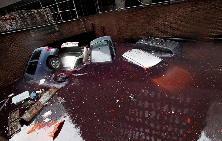 Cars are submerged at the entrance to a parking garage in New York's Financial District in the aftermath of superstorm Sandy, Tuesday, Oct. 30, 2012. New York City awakened Tuesday to a flooded subway system, shuttered financial markets and hundreds of thousands of people without power a day after a wall of seawater and high winds slammed into the city, destroying buildings and flooding tunnels.   (AP Photo/Richard Drew)