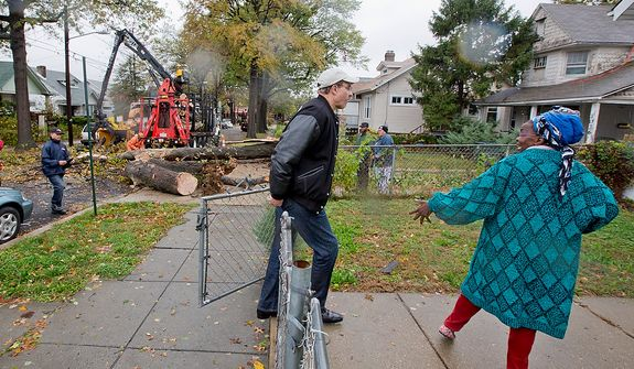 Mayor Vince Gray visits a resident affected by hurricane Sandy, where a downed tree has blocked the road on Evarts St NE, Washington, D.C., Tuesday, October 30, 2012. Mayor Gray surveys the damage as part of his job as Mayor of D.C., to ensure residents are taken care of. (Andrew S. Geraci/The Washington Times)