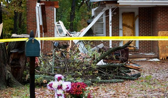 One man found dead in his home last night after a tree fell onto his house and went though his living room, Pasadena, Md., Tuesday, Oct. 30, 2012. (Craig Bisacre/The Washington Times)