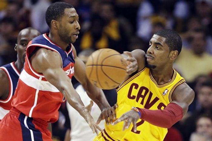 Cleveland Cavaliers' Kyrie Irving (2) passes away from Washington Wizards' A.J. Price in the first quarter of theie season-opening NBA game, Tuesday, Oct. 30, 2012, in Cleveland. (AP Photo/Mark Duncan)
