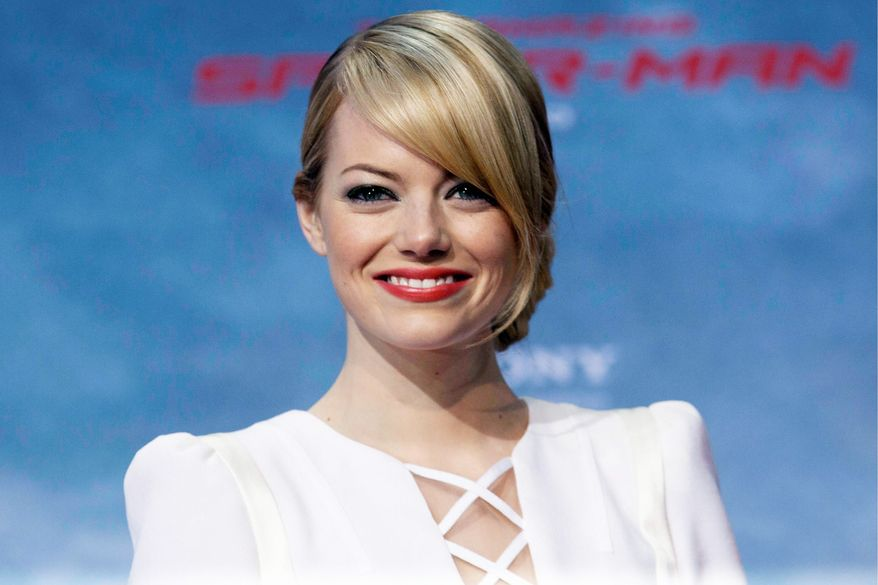 "FILE - This June 20, 2012 file photo shows actress Emma Stone at the German premiere of the movie ""The Amazing Spider- Man,"" in Berlin. Stone, Justin Bieber, Tyra Banks and Josh Duhamel are honoring teenagers who give back to their communities. Nickelodeon announced Tuesday, Oct. 30, that each star will pay tribute to a teen volunteer at the fourth annual TeenNick HALO Awards in November. (AP Photo/Markus Schreiber, file)"
