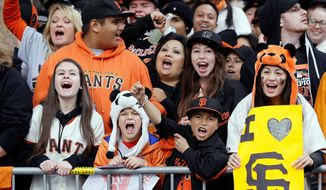 associated press  Giants fans lined up to cheer their World Series heroes at a parade Wednesday. The next order of business is the front office figuring out which players will be back in 2013 to defend San Francisco's title.