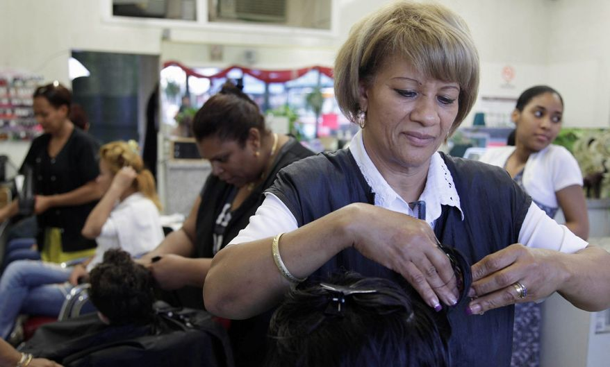 Milagros Rodriguez, from the Dominican Republic, works at her salon, Woodside Beauty Salon in Queens, N.Y. A study says two-thirds of job growth since 2009 has been among immigrants. (Associated Press)